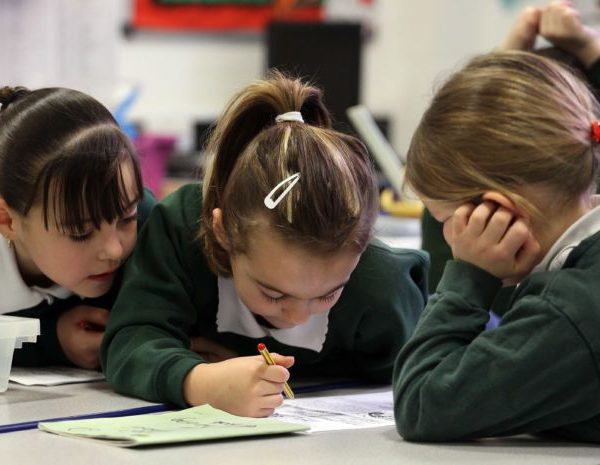 School pupils at the Bridge Learning Campus work together in a classroom at the school on February 24, 2010 in Bristol, England.