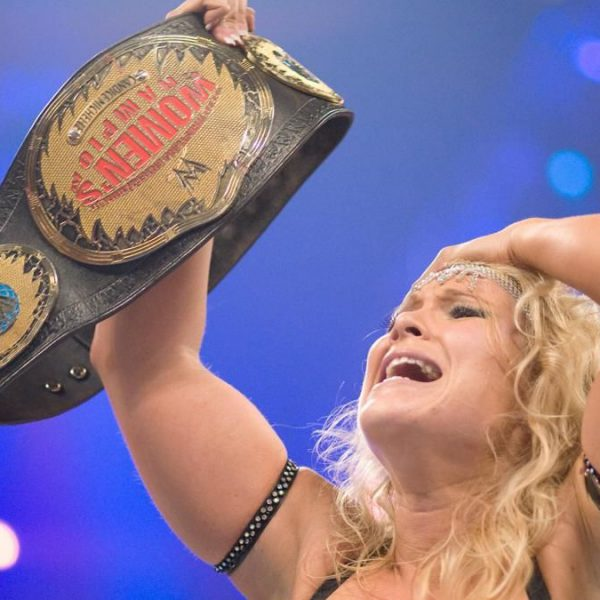 Beth Phoenix holds up the Women