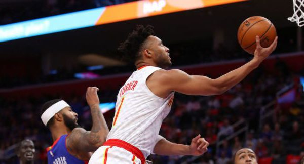Evan Turner of the Atlanta Hawks attempts a shot against the Detroit Pistons.