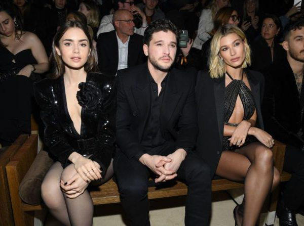 Lily Collins, Kit Harington and Hailey Baldwin attend the Saint Laurent show